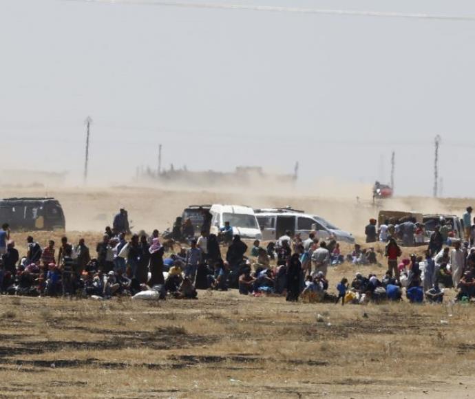פליטים נמלטים מארגון דאעש בסוריה