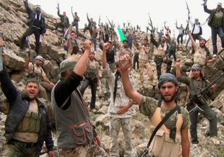 המורדים הסורים. פתחו במתקפה נגד כוחות אסד תוך שימוש בכלי נשק מתקדמים. צילום: רויטרס