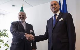 """לורן פביוס ומוחמד זריף במפגש באו""""ם ב-2013"""