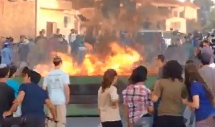 שריפת פח במהלך העימותים בבית אל