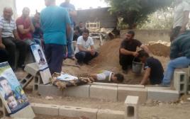 הקבר של ריהאם דוואבשה בכפר דומא
