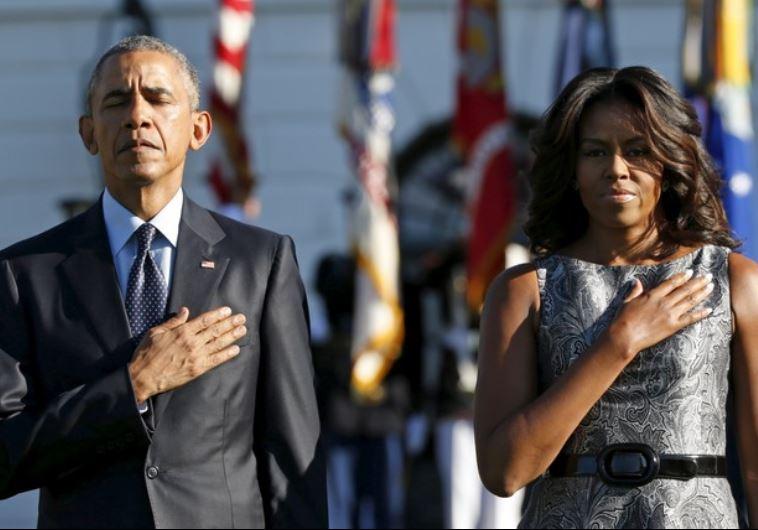 ברק ומישל אובמה בדקת דומיה לזכר קורבנות אסון התאומים