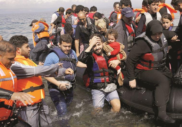 פליטים סורים ביוון. צילום: רויטרס