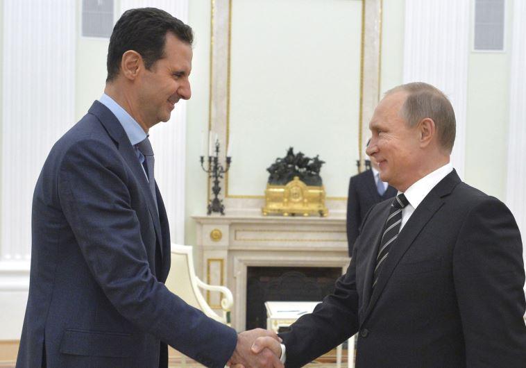 הקואליציה ביניהם ממשיכה לשאוב כוח מסדרה של התפתחויות לטובתה. פוטין ואסד במוסקבה, אוקטובר האחרון. צילום: רויטרס
