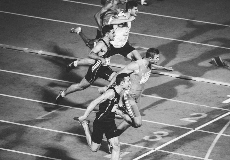 גמר 100 מטרים גברים באליפות ישראל באתלטיקה. צילום: אסף קליגר