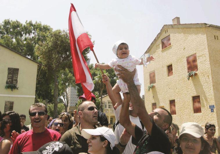"""""""הם בעלי ברית שלנו, אבל לא נלחמו בשבילנו"""". הפגנה של אנשי צד""""ל בתל אביב, 2008. צילום: רענן כהן"""