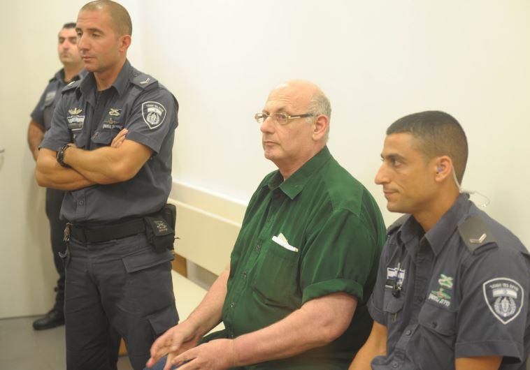 שמעון קופר בבית המשפט בעת הקראת הכרעת הדין. אבשלום ששוני