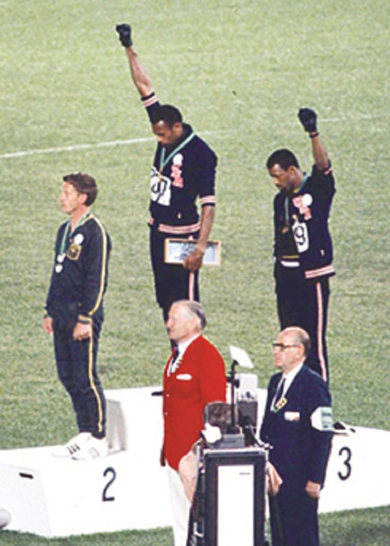 'הצדעת הכוח השחור', טקס המדליות באולימפיאדת מקסיקו. צילום: אנג'לו קוזי