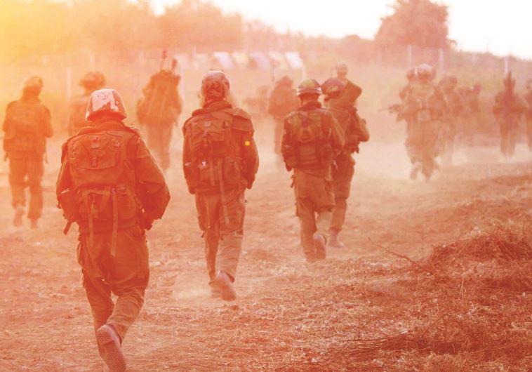 """חיילי צה""""ל במלחמת לבנון השנייה. צילום: פייר תורג'מן, פלאש 90"""