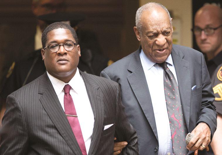 ביל קוסבי ופרקליטו. צילום: AFP